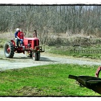old red tractor on road