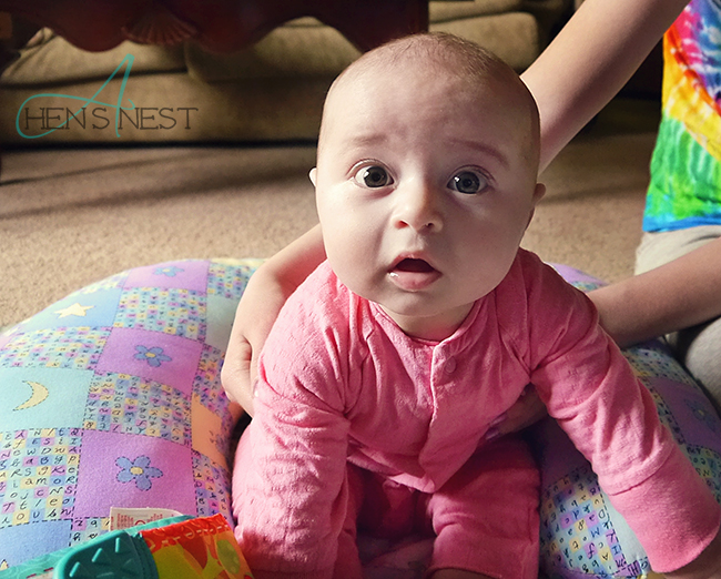 wide-eyed grand baby