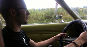 Tom driving the Mustang