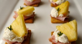 brown rice style triscuit cracker with pineapple, ham and cream cheese topper