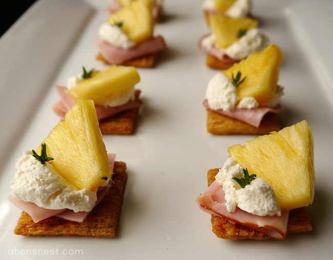 triscuit brown rice style cracker with pineapple, ham and cream cheese topper