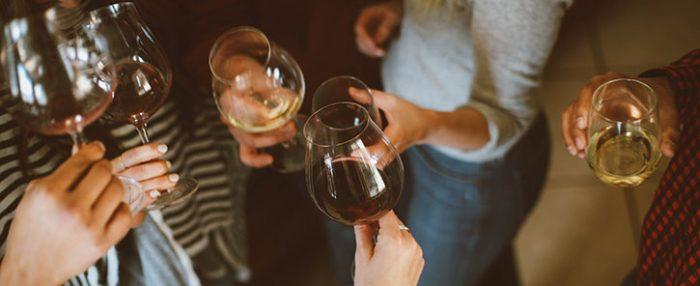 Wine glasses toasting wine tasting